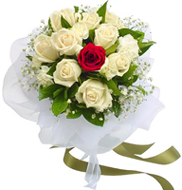 Eleven White and one Red Rose in a Bouquet